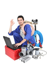plumber kneeling with computer doing OK sign