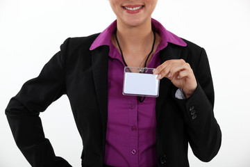 Woman displaying visitor badge
