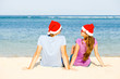 beautiful coulpe in santa hats on tropical beach of Bali