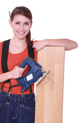 Woman laying wood flooring