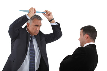 Angry boss about to hit employee with clip-board