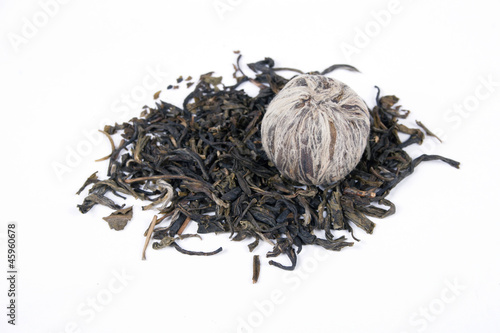 Dried leaves of pu-erh tea isolated on white background