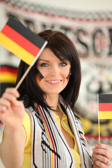 Germany supporter holding miniature flags