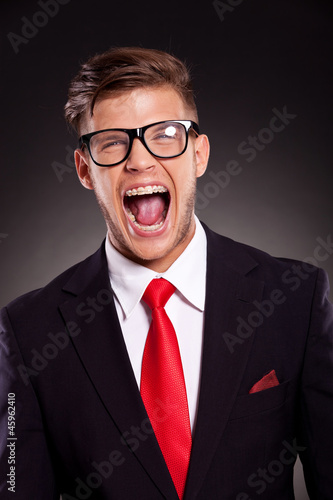 young business man shouting