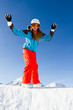 Winter fun - portrait of young snowboarder girl