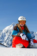 Winter sports - portrait of young snowboarder girl