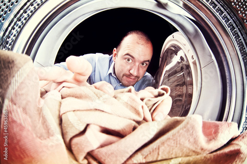 man and washing machine