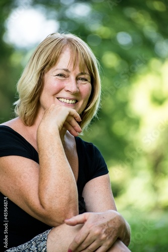 Smiling mature woman outdoor portrait