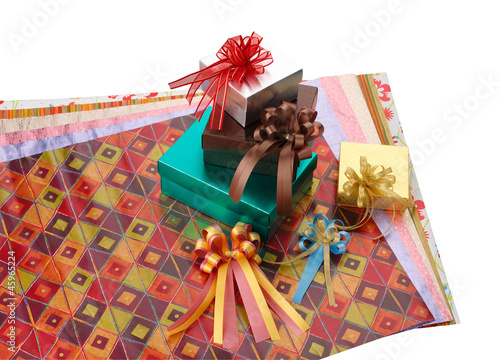 Colorful gift box with wrapping papers