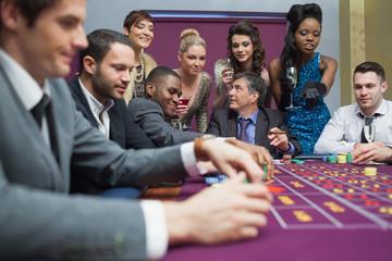 Women watching men play roulette