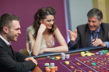 Men and woman talking at craps game