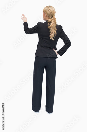 Reversed businesswoman showing something