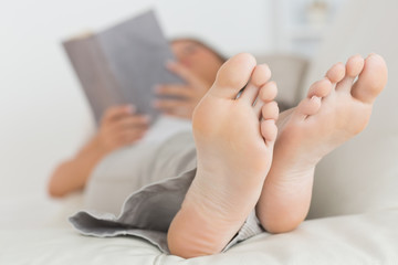 Woman with her feet up reading a book