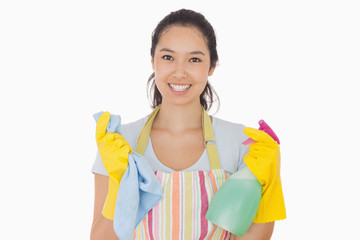 Woman holding cloth and spray bottle
