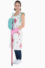 Woman with gloves apron and mop
