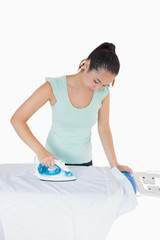 Woman ironing a shirt