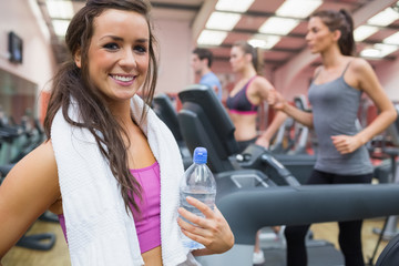 Woman happy in the gym after exercise
