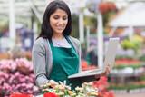 Woman checking stocks in garden center