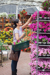 Cheerful woman taking a flower