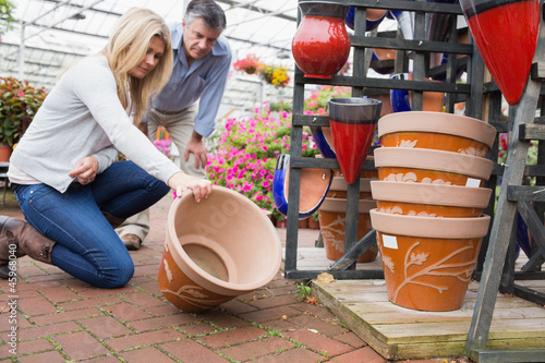 Couple looking at a pot