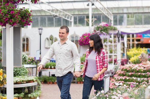 Couple walking through a garden center