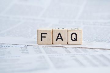 Würfel auf Zeitung - FAQ