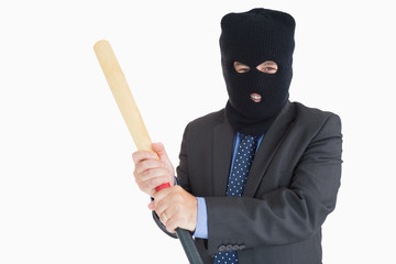 Smiling businessman dressing like a burglar