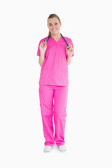 Smiling woman in pink scrubs