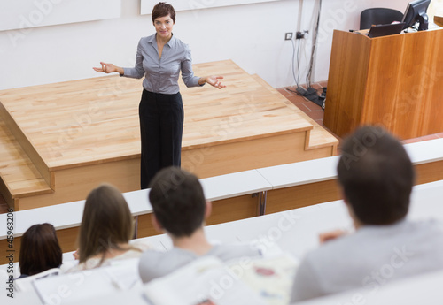 Teacher standing talking to the students
