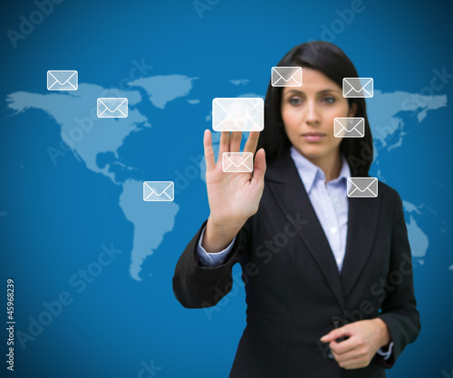 Businesswoman selecting email symbol from many