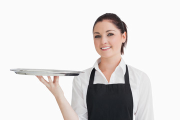 Waitress holding empty tray