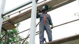 Construction Worker Welding Steel
