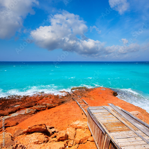Cala Saona coast with turquoise rough Mediterranean