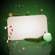 Christmas card with ornaments with green background