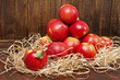 red apples on a old brown wooden background