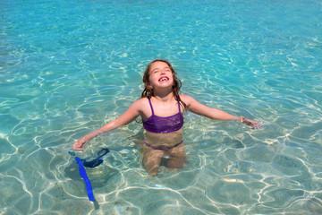 aqua water beach and open arms bikini little girl