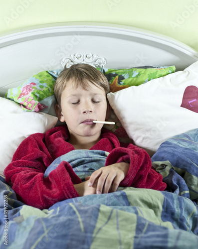 Boy in bed with fever