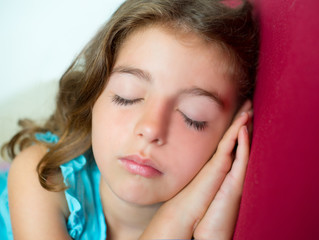 beautiful brunete kid girl sleeping hands together