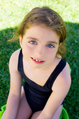brunette children girl smiling with swim suit
