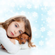 christmas children girl hug a puppy brown dog