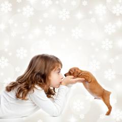 christmas children girl hug a puppy brown dog