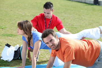 Group doing push-ups in park