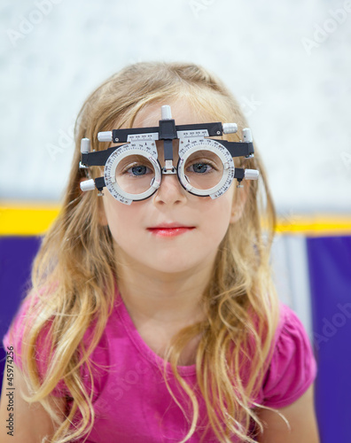 blond children girl with optometrist diopter glasses