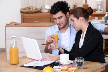 Woman going over a work presentation with her boyfriend
