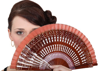 Woman holding fan