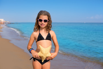 blue beach girl with bikini starfish and sunglasses