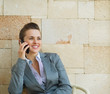 Happy business woman speaking mobile phone