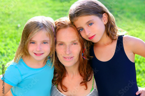 mother and two sister daughters in the garden