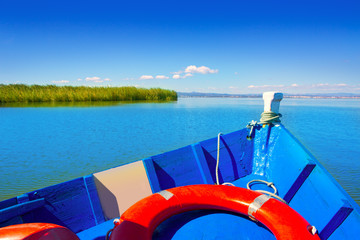 Blue boat sailing in Albufera lake of Valencia