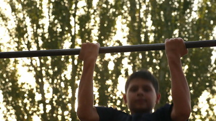 teenager doing pull ups 12